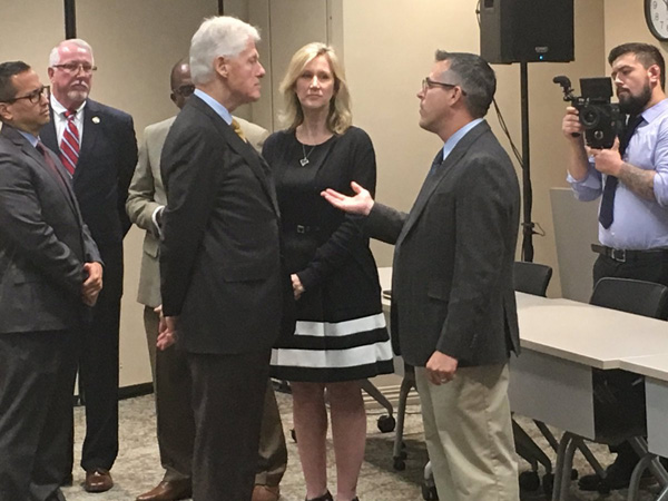 Joseph Cammilleri, Pharm.D., speaks with former President Bill Clinton about the opioid crisis during Clinton's visit to Northeast Florida.