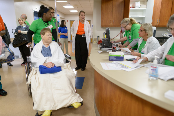 Kim Stone, 55, of Crystal River, who is recovering from a recent minor stroke, is in the final leg of being transported to her new room in the new hospital.