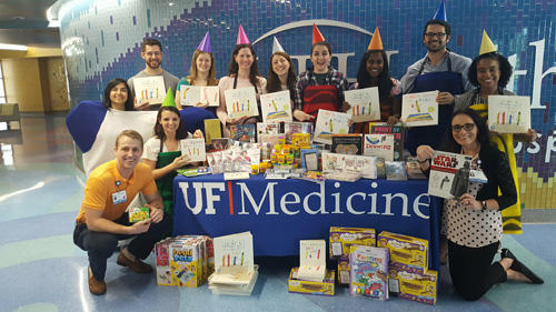 Even though the flu epidemic forced the UF College of Medicine White Coat Company to postpone its performance for patients at the UF Health Shands Children's Hospital, the theater troupe collected donated books, drawing and paint sets, Play-Doh and four Amazon Kindles among other supplies for the pediatric patients.