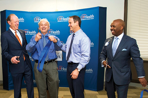 With the snip of scissors, Marco Pahor, M.D., director of the UF Institute on Aging, cut the ribbon to the new JAX—ASCENT center. With him are, from left, David S. Guzick, M.D., Ph.D., who stepped down in July as senior vice president for health affairs and president of UF Health; Stephen Anton, Ph.D.; and Leon L. Haley, M.D., MHSA, CEO of UF Health Jacksonville and dean of the UF College of Medicine – Jacksonville