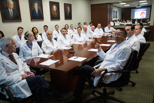The UF College of Medicine's department of urology's chair , Li-Ming Su, M.D., right, and fellow urologists from the department gather in their urology conference room to discuss recent cases.