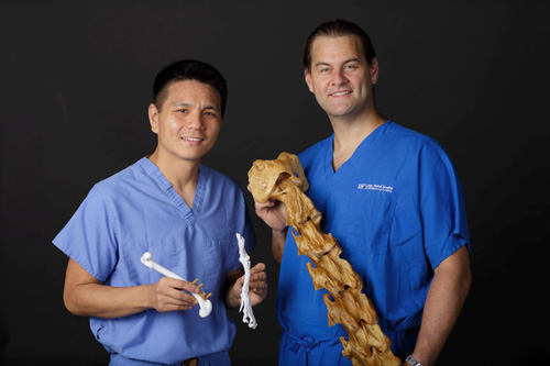 "Stanley Kim, B.V.Sc., left, an associate professor at the UF College of Veterinary Medicine, and Adam Biedrzycki, B.V.Sc., Ph.D., an associate professor at the college, use the 3-D printer to develop bone models that ""actually feel and handle like the real thing.''"
