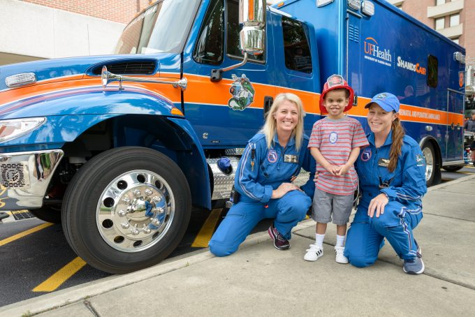 UF Health pediatric heart transplant candidate Antonio Smith enjoyed a special moment with UF Health ShandsCair flight team members in front of UF Health Shands Hospital. The UF Health Congenital Heart Center team made this wish come true for Antonio knowing his love for fire engines and ambulances, and the first responders who save lives every day.