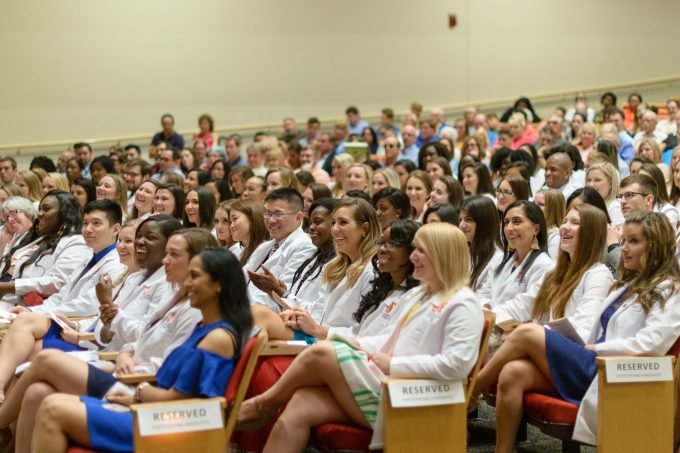 UF College of Nursing students enjoy a laugh during their Pinning Ceremony, a milestone moment in their professional career.