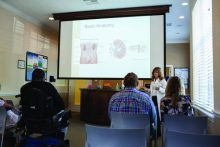 Teri Booth Martinez, a physician's assistant at the Chronic Kidney Disease Education Clinic at UF Health, addresses patients and family members during a clinic education session.