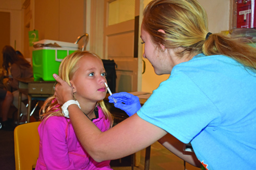 UF College of Nursing students visited area elementary schools to administer the nasal mist flu vaccine as part of the Control Flu program.