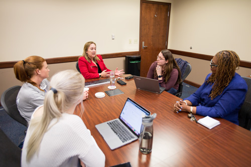 UF College of Nursing undergraduate students in the EMBRACE program participate in a faculty mentoring session with associate professor Jeanne- Marie Stacciarini, Ph.D., R.N., FAAN, and clinical assistant professor Paula Delpech, Ph.D., R.N., APRN.