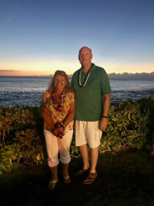 Maureen Stowell and her husband, Richard, enjoying a sunset on a trip to Hawaii