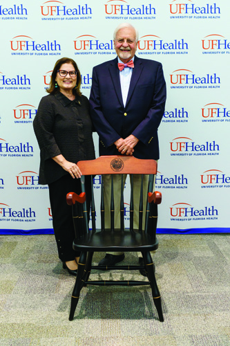 UF College of Dentistry Dean A. Isabel Garcia, D.D.S., M.P.H., joins M. Franklin Dolwick, D.M.D., Ph.D., after he was named the Academy One Hundred Eminent Scholar.