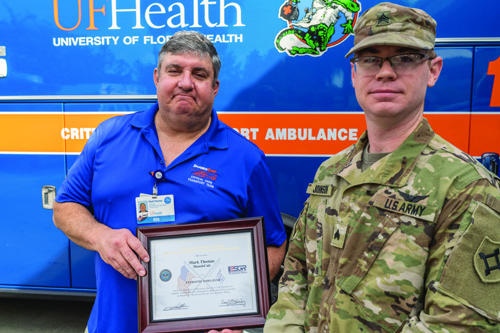Michael Johnson, right, a ground medic for the UF Health ShandsCair team and a member of the Florida National Guard, nominated his supervisor, Mark Thomas, B.S.N., R.N., EMT-P, for the National Guard's Patriot Award in appreciation for Thomas' support of his service in both areas of his career.